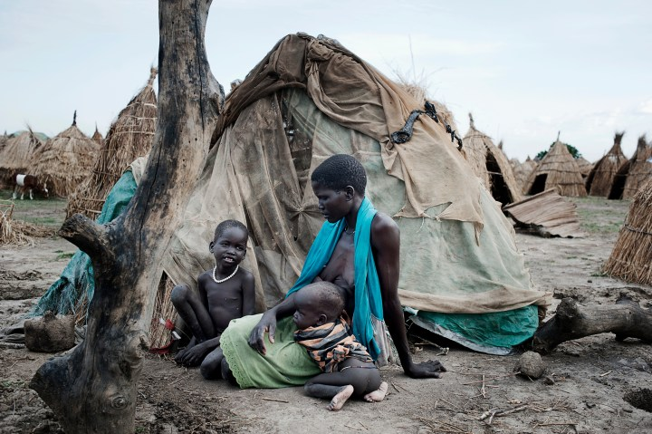 Ganyiel, Unity State, South Sudan, April 21 2014: Rebbecca Nyaknme fled the fighting in Bentiu together with her family. Only her and two children arrived after they were separated from the husband and the other two children. Rebbecca and the two children live in simple straw huts on the outskirts of Ganyiel. Having lost everything they own, they arrived in Ganyiel empty-handed. Their survival relies on foreign aid, and without emergency food they will starve. Source: World Humanitarian Summit, Flickr