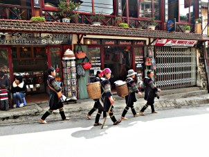 Local Tribe Women walk through the streets of Sa Pa Town
