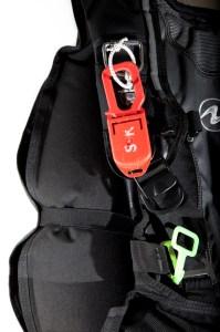 Line cutter on shoulder strap.