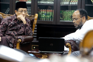 Presenting the UQA program to the head priest at Mosque Istiqlal, Jakarta