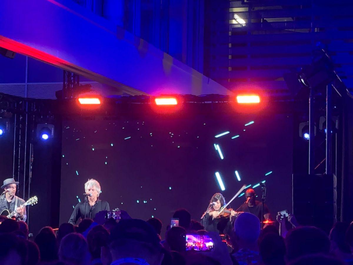 Jon Bon Jovi and band on stage