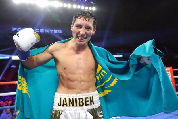 Janibeck Alimkhanuly celebrates a victory