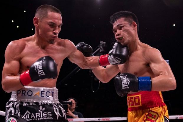 Estrada lands a left hook, Photo: Lina Baker