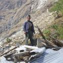 Man standing in earthquake ruble.