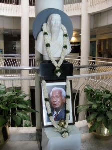 Images of Aravind's founder, Dr. G. Ventakaswamy, are displayed prominently around the campus.