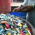 man sorting electronic components