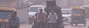 Men on bikes in Delhi