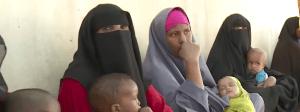 Somali women wait with babies