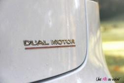 Essai Tesla Model 3 Performance 2019 logo détail dual motor transmission intégrale