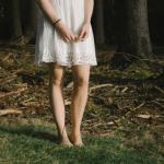 woman white dress by herself