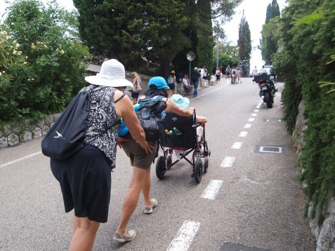 pushing the chair up the hill