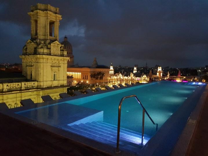 Rooftop pool at Gran hotel Manzana Kempinski during the night