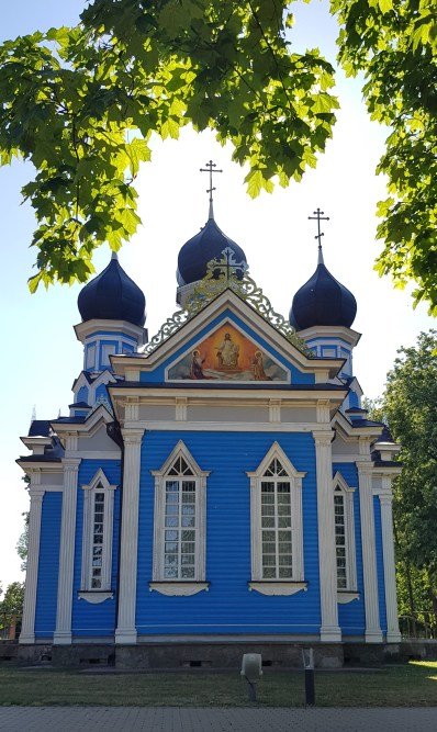 Sun behind The Blue Church in Lithuania