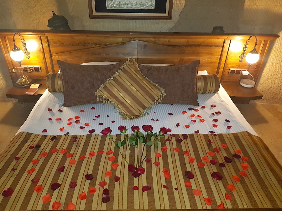 Rose petals on the bed in Kayakapi the most romantic hotel in Cappadocia