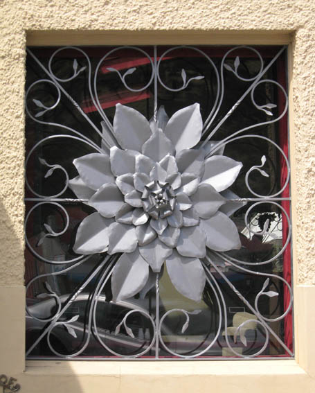 A flower sculpture in a window