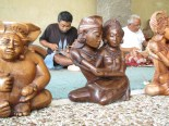 Wood carvers at work behind their creations. The one in the center is Rama and Sita, from the ancient Sanskrit epic the Ramayana.