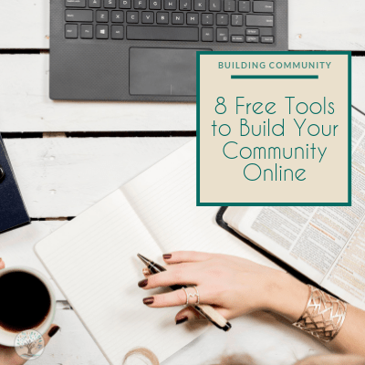 "A women working at a table with pen in her right hand posed to write and a coffee mug in her left hand. In front of her is her laptop and to her right is an open book. Text overlay reads ""Building Community 8 Free tools to build your online community"""