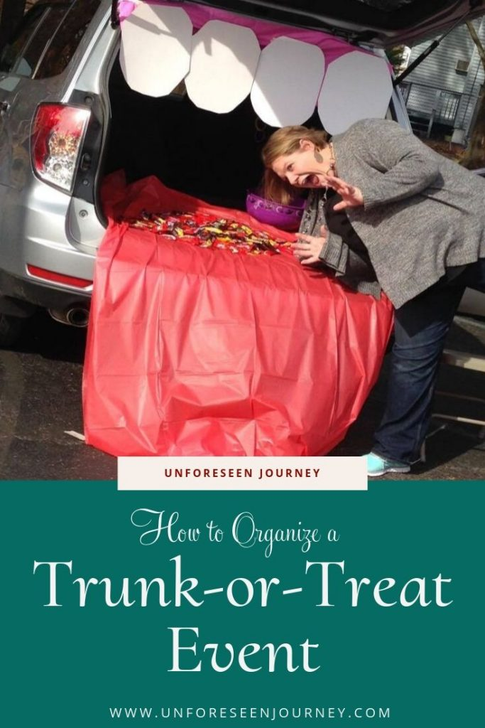 "A trunk decorated for a trunk-or-treat event as a large mouth with teeth and a tongue sticking out. One of the volunteer is pretending to be eaten. Text at the bottom reads ""Unforeseen Journey – How to organize a Trunk-or-Treat Event"""