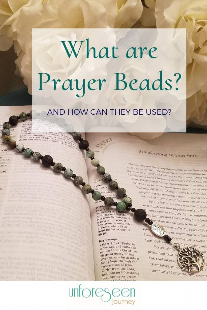 "A set of green prayer beads laid on top of a bible open to 1 Peter. Text overlay reads, ""What are prayer beads and how can they be used?"""