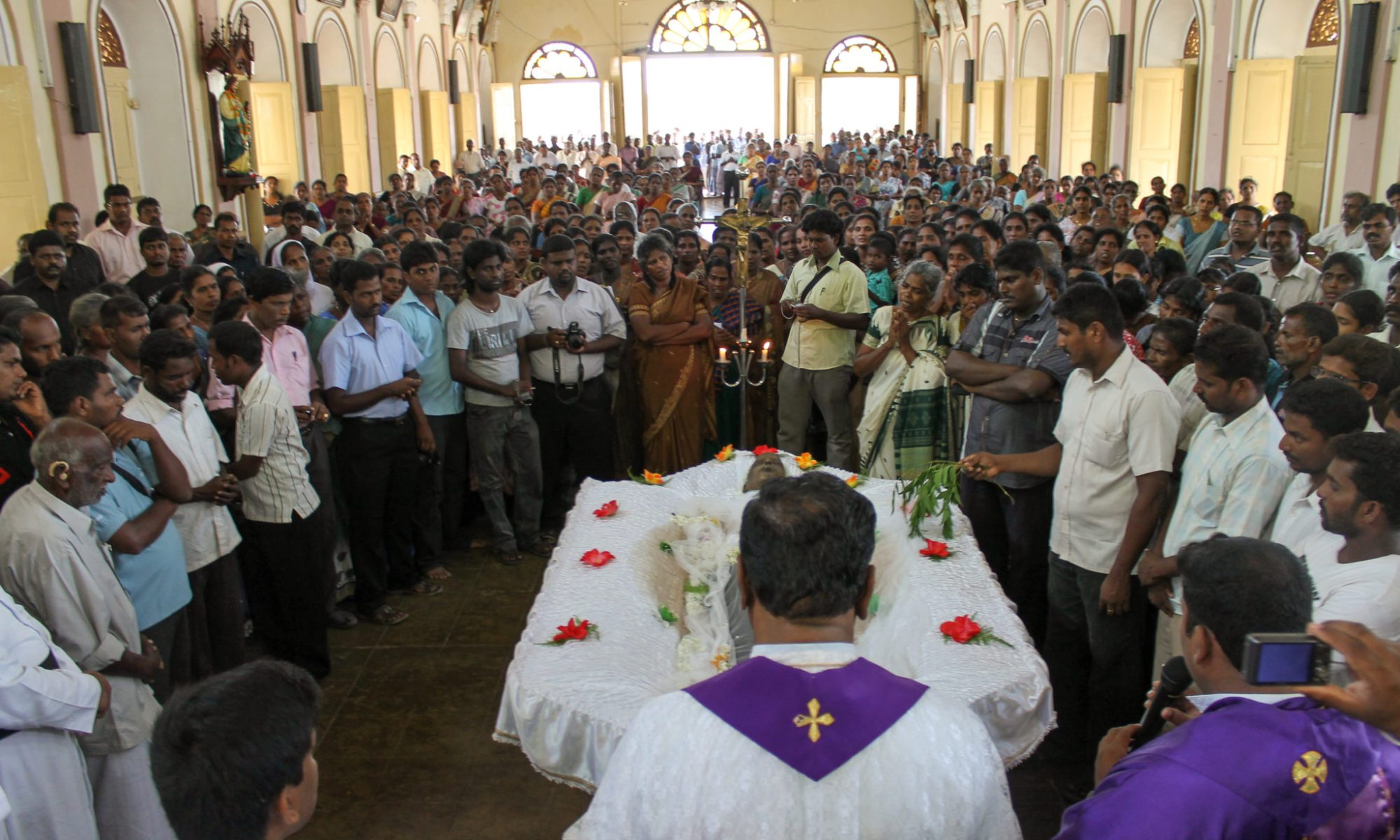 8th August 2012 Paithakuur, Jaffna Performing the Funeral traditions under high security for 34 Year Delruxon Mariyathas