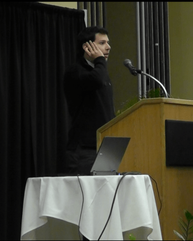 Pre-med freshman Omar Zeinlabdin gives an example of the Muslim Call to Prayer at the lecture March 2.