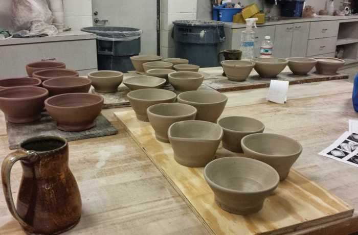 These bowls, created by UNF ceramics students, are waiting to be fired. Photo by Jocelyn Tolbert