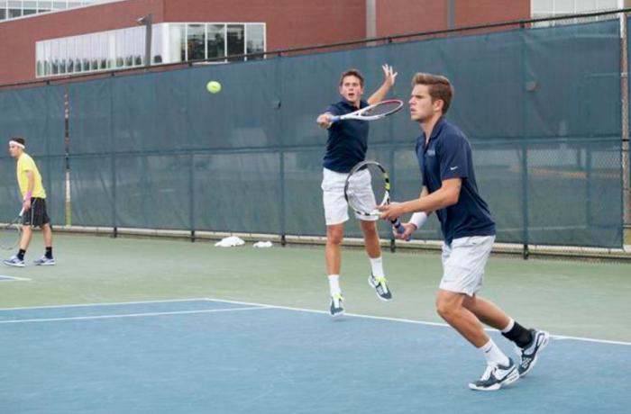 Findel-Hawkins returns a serve in a match against ETSU. Photo by Joshua Brangenberg.