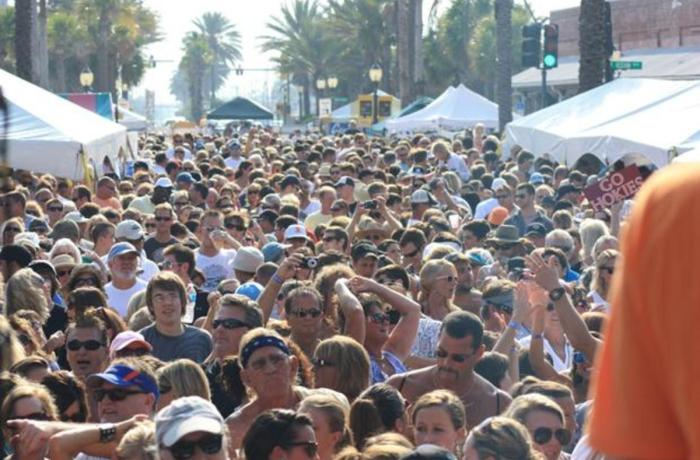 Crowds of people flood the streets of Neptune Beach during the 2010 celebration. Photo courtesy Kendra Robertson.
