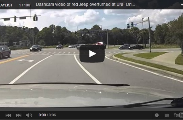 Video: red Jeep overturned at UNF Drive and Eco Road intersection