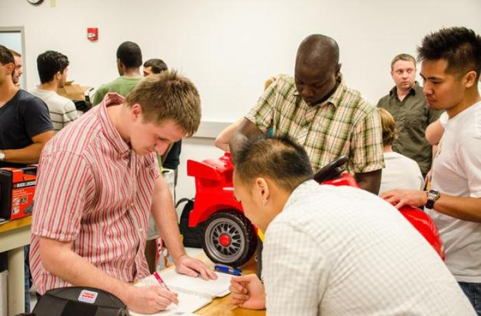 Engineering students redesign ride-on toy cars to meet the needs of children with physical disabilities. Photo by Robert Curtis