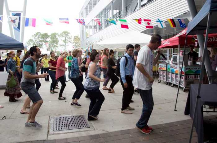 "The DJ led a couple students and teachers in the ""Cha Cha Slide."" Photo by Kimberly Appleby"