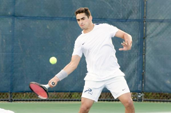Men's tennis battled the weather to win one of two games this weekend Photo by Ashley Saldana