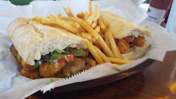 The shrimp po' boy is stuffed with crunchy fried shrimp and juicy tomatoes. Photo by Courtney Stringfellow