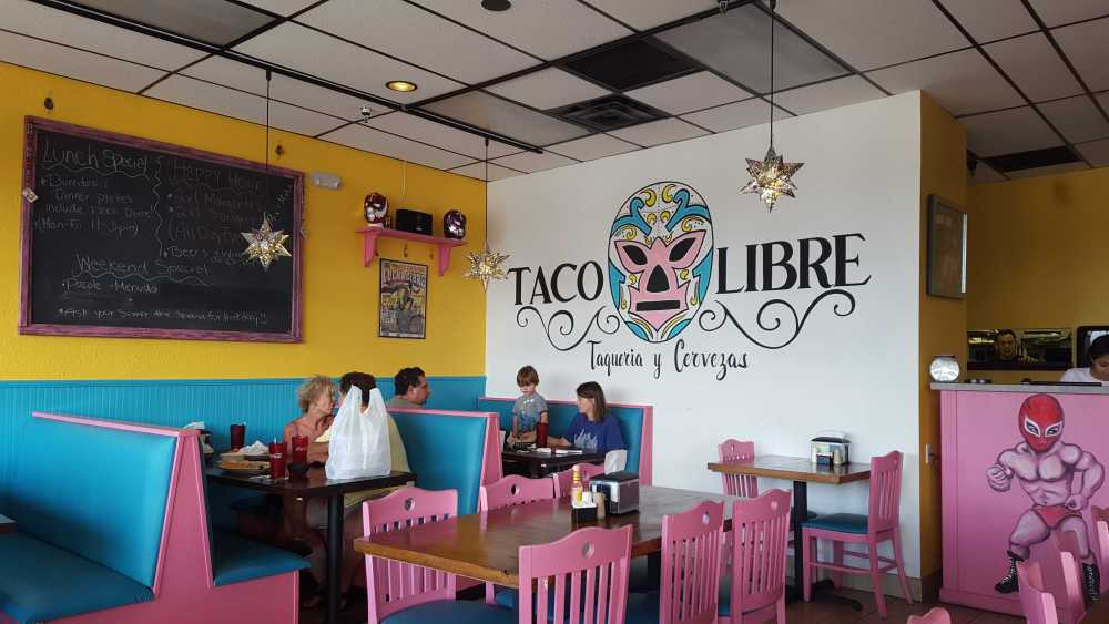 Colorful masks, star-shaped lights and painted luchadors make Taco Libre a lively place to celebrate a night out. Photo by Courtney Stringfellow
