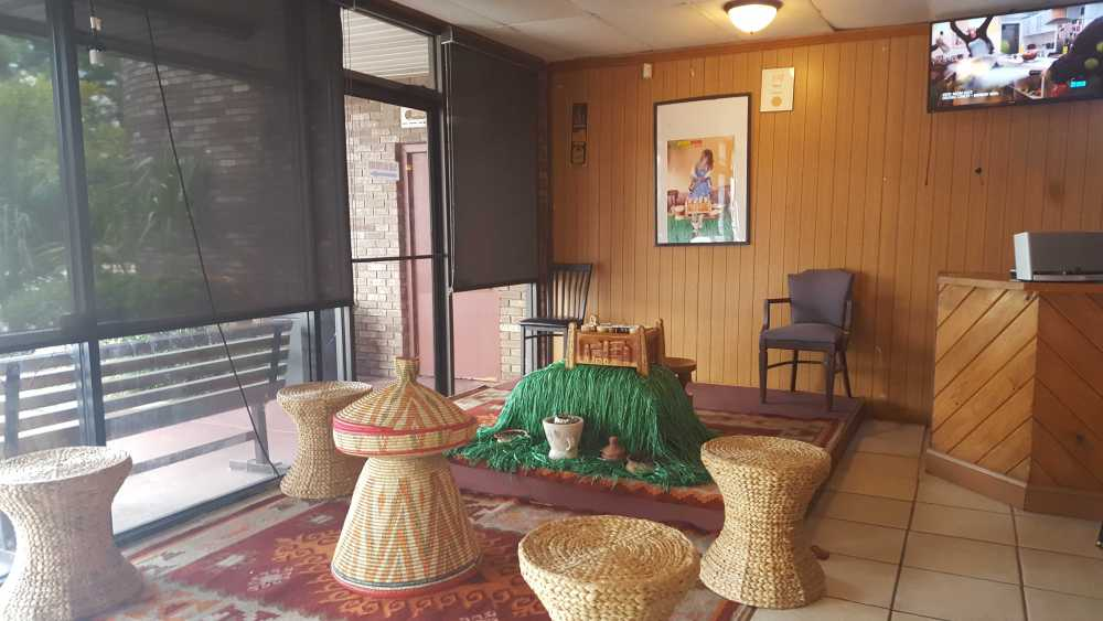 The woven baskets and colorful cups by the entrance are for the Ethiopian Coffee Ceremony — a lengthy coffee brewing ritual involving roasting, grinding and slowly brewing coffee grounds. Photo by Courtney Stringfellow