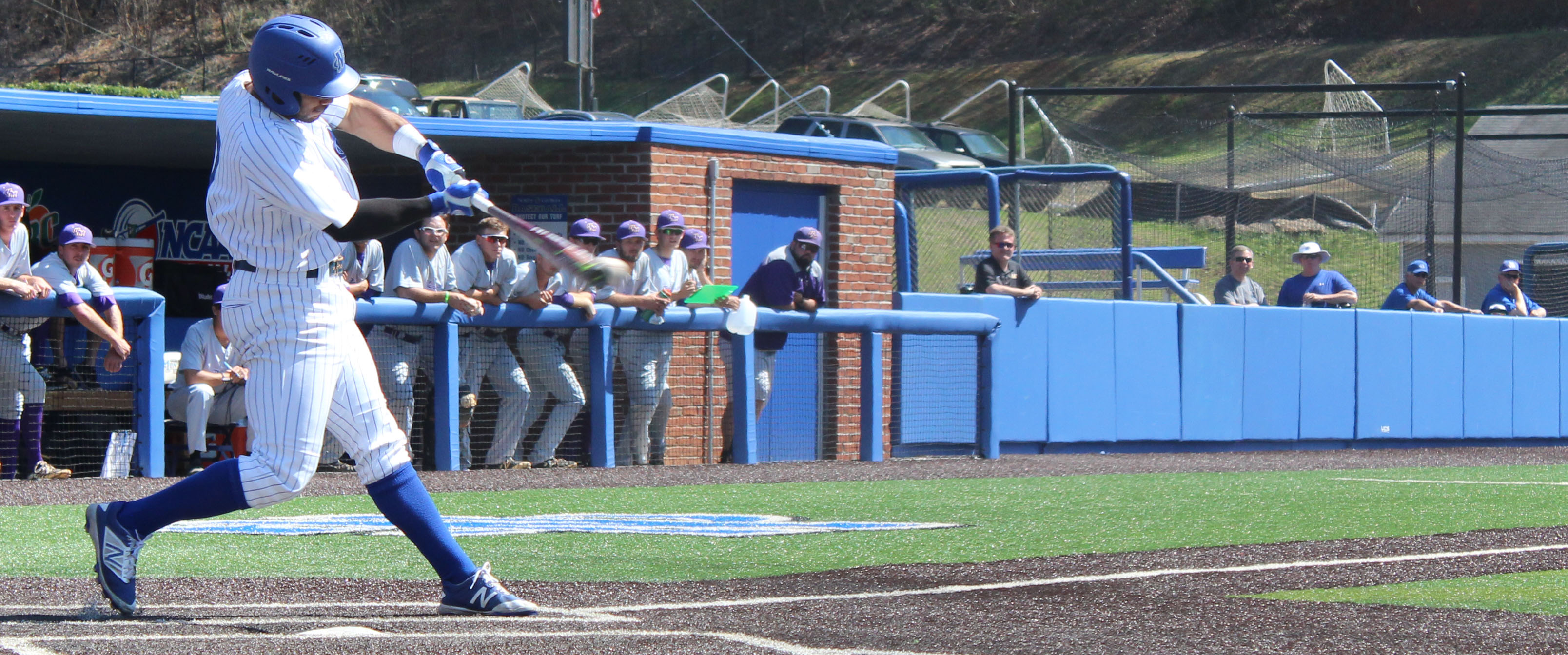 Mike Bell mashes the ball for a double during a 15-4 victory over Montevallo University. (Photo by Jake Cantrell)