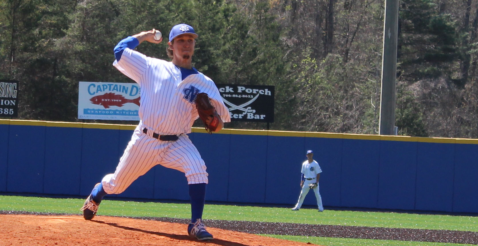 UNG pitcher Dylan Peppers reaches back to deliver a pitch during Sunday's game against Montevallo. (Photo by Jake Cantrell)