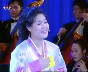 Kim Myong-sin 김명신 is a rare guest. She performed also twice in 2012 and once in 2013)