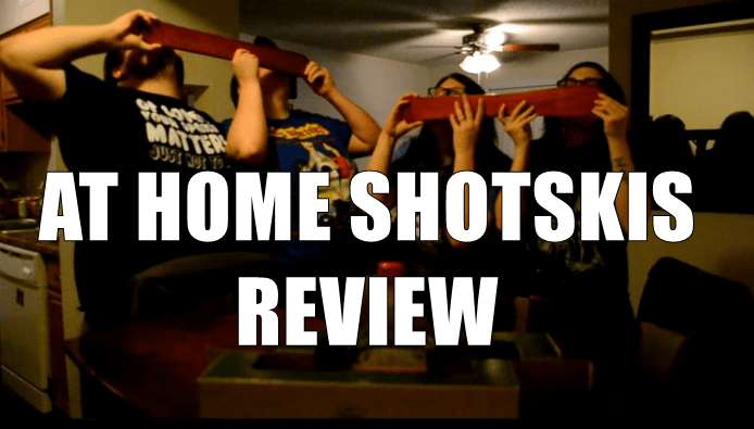 Four people doing two tandem shotskis with at home shotski review overlay