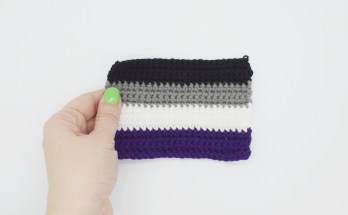hand holding a crochet asexual pride flag