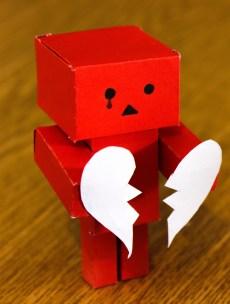 broken hearted red robot