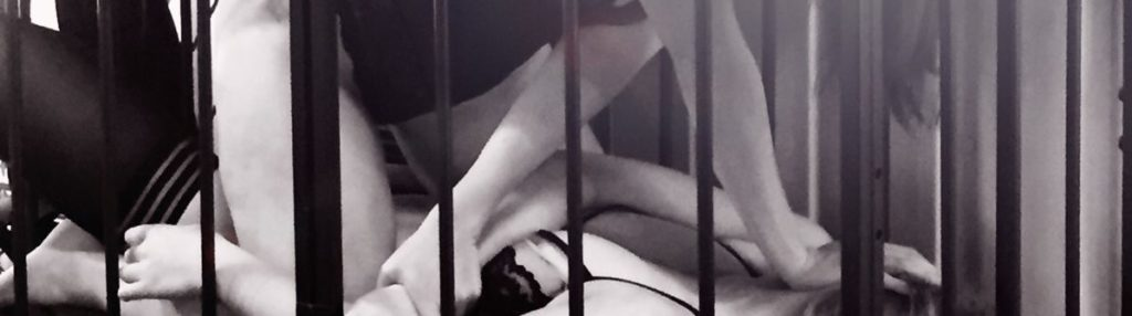 two women play wrestling in a cage in photo shoot for unicorn hunting blog