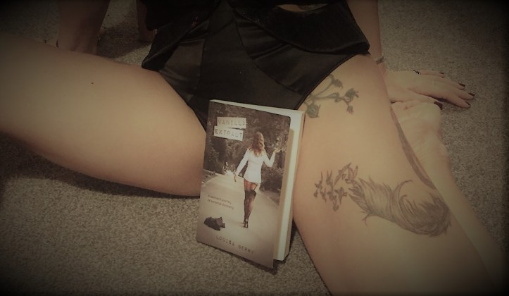 Vanilla extract book displayed between the legs of the author