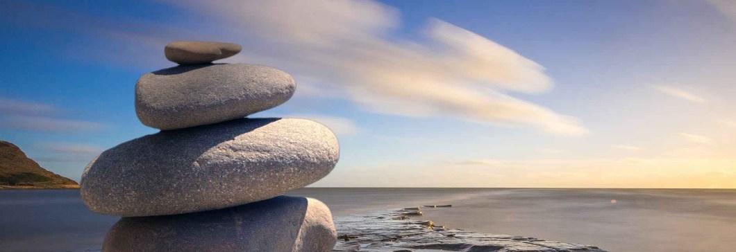 boulders balanced on the beach