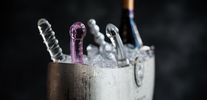 glass dildos and champagne in an ice bucket