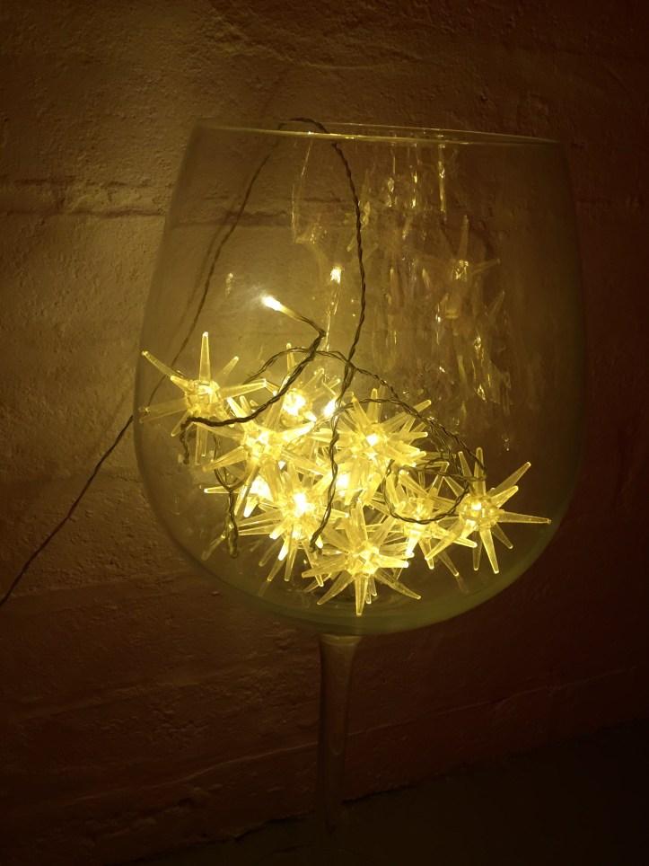 A large goblet filled with lights