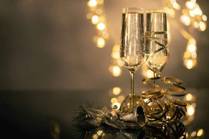two wine champagne glasses with gold ribbon