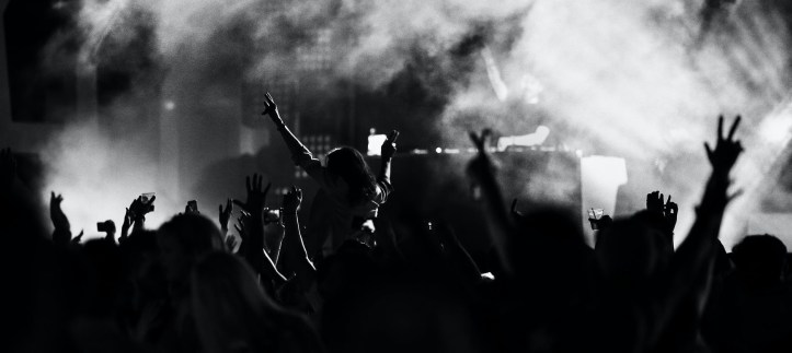 black and white image of people at a party in smoke