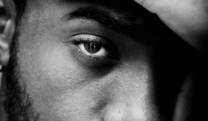 eye of a bearded black man