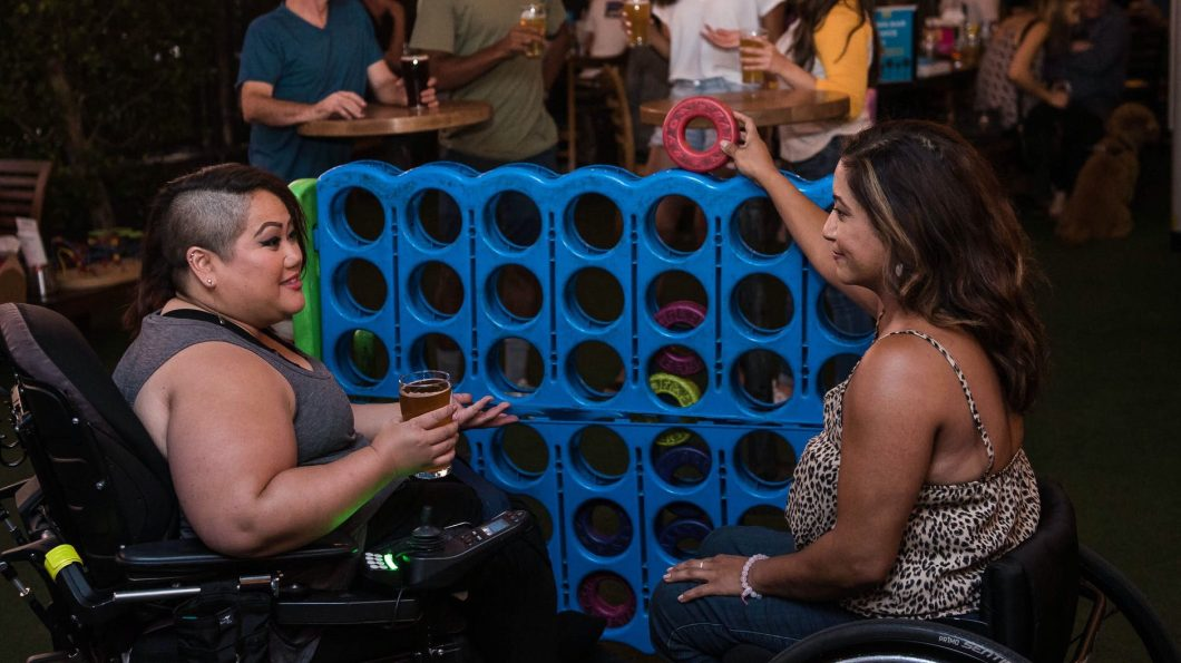 lesbians in wheelchair playing connect 4